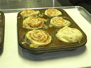 Once you've added the buns to the pan, place in warm area in kitchen and allow them to rise for an hour.