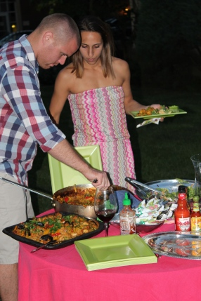 Dea and her husband, Hugo, helping themsleves to paella before joining everyone at the table.